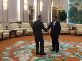 The chairman of the Joint Chiefs of Staff, meets Chinese President Xi Jinping.