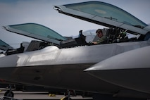 U.S. Air Force Capt. Flash, F-22 Raptor pilot, prepares to start engines during the first flight of Red Flag 17-4 at Nellis Air Force Base, Nev., Aug. 14, 2017. Red Flag is a realistic combat training exercise involving the air, space and cyber forces of the United States and its allies. (U.S. Air Force photo/Staff Sgt. Carlin Leslie)