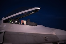 U.S. Air Force Staff Sgt. Courtney Puyear, 94th Aircraft Maintenance Unit crew chief, inspects the cockpit of an 94th Fighter Squadron F-22 Raptor, during Red Flag 17-4 at Nellis Air Force Base, Nev., Aug. 14, 2017. (U.S. Air Force Photo/Staff Sgt. Carlin Leslie)
