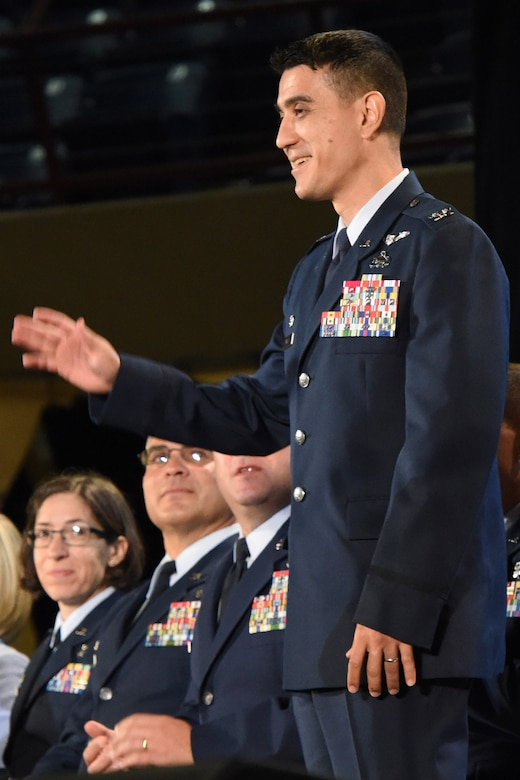 U.S. Air Force Col. Ricky Mills, 17th Training Wing commander, stands for recognition during the annual convocation of the San Angelo Independent School District at the Foster Communications Colosseum, San Angelo, Texas, Aug. 15, 2017.