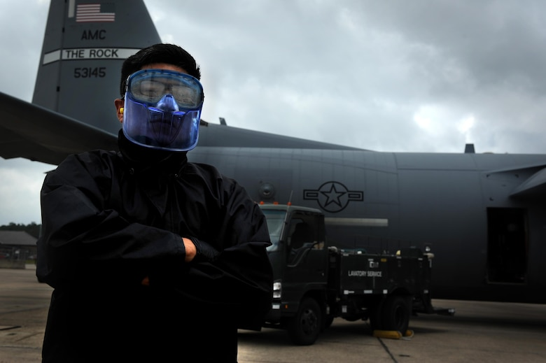 Airman 1st Class Jose Chala, 19th Logistics Readiness Squadron Fleet Services element member, operates a lavatory services truck to dispose of solid waste from a C-130J Aug. 16, 2017, at Little Rock Air Force Base, Ark. The team services approximately 25 aircraft daily, including transient aircraft. (U.S. Air Force photo by Airman 1st Class Grace Nichols)