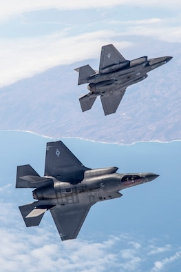 A pair of F-35s soar over the Pacific Ocean range near NAWS Point Mugu during a recent Weapons Delivery Accuracy testing surge. (Photo by Darrin Russel/Lockheed Martin)