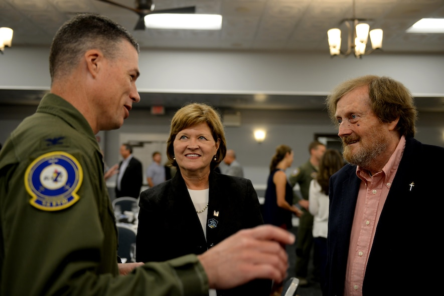 """Col. Douglas Gosney, 14th Flying Training Wing Commander, Justice Sharon Lee, from the Tennessee Supreme Court, and Rufus Ward Jr., retired attorney and Columbus native, speak before the Base Community Council luncheon Aug. 11, 2017, on Columbus Air Force Base, Mississippi. Lee and Ward's fathers worked together on the B-17 Flying Fortress, """"Smokey Stover Jr.,"""" that was shot down May 12, 1944, over Frankfurt, Germany. (U.S. Air Force photo by Airman 1st Class Keith Holcomb)"""