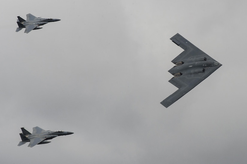 Three aircraft fly in formation