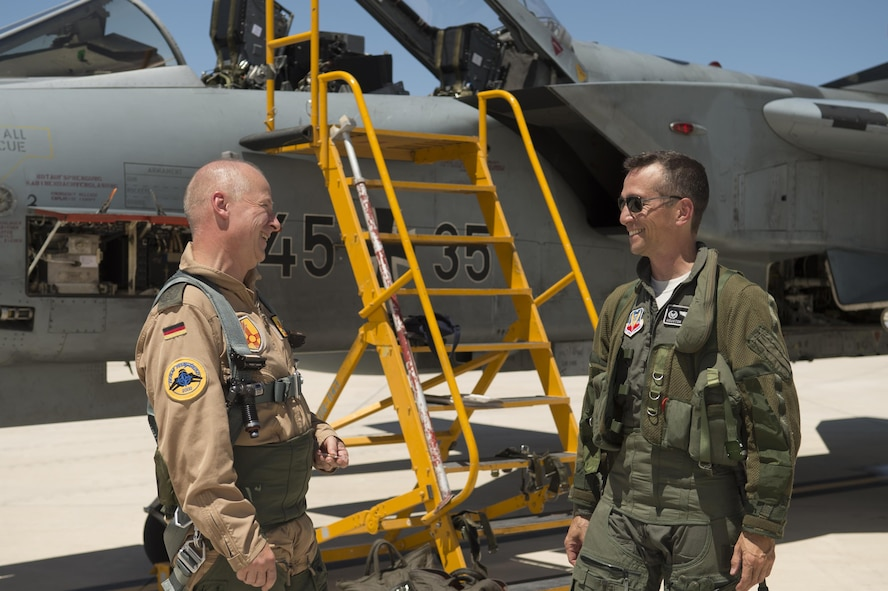 Col. Stephan Breidenbach, German air force Flying Training Center commander and Col. Houston Cantwell, 49th Wing commander, talk after flying the last mission as next-door neighbors. The GAF has entered its final stage of departure, however they will not complete their departure from Holloman AFB until mid 2019. (U.S. Air Force photo by Tech. Sgt. Amanda Junk)