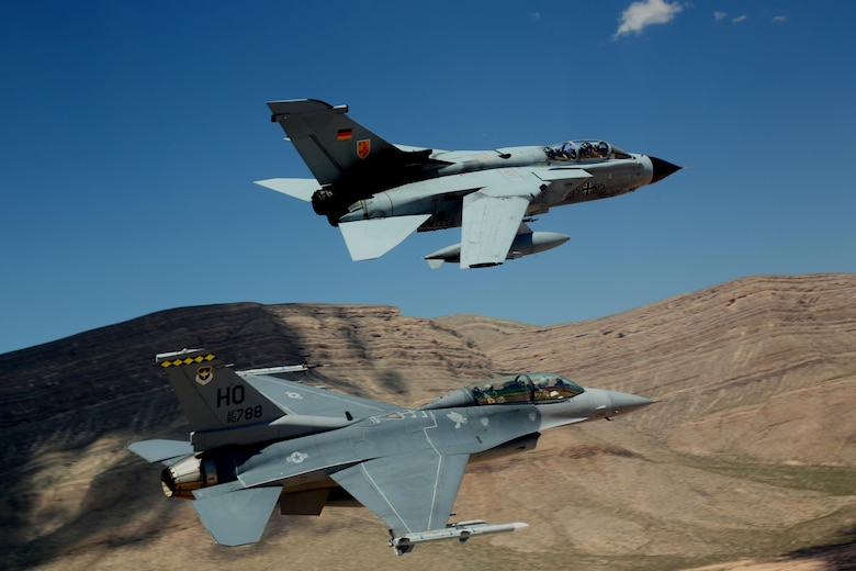 """A German air force Tornado and an F-16 Fighting Falcon assigned to the 314th Fighter Squadron fly in formation together during the last joint flying mission at Holloman Air Force Base, Aug. 17, 2017. The GAF has entered its final stage of departure, however they will not complete their departure from Holloman AFB until mid 2019. (U.S. Air Force photo by Maj. Bradford """"Emcon"""" Brizek)"""