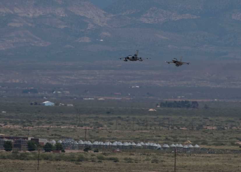 A German air force Tornado aircraft and an F-16 Fighting Falcon perform their last flight together with senior leaders from their respective commands at Holloman Air Force Base, N.M., Aug. 17, 2017. The German air force has entered its final stage of departure, however they will not complete their departure from Holloman AFB until mid 2019. (U.S. Air Force photo by Senior Airman Chase Cannon)
