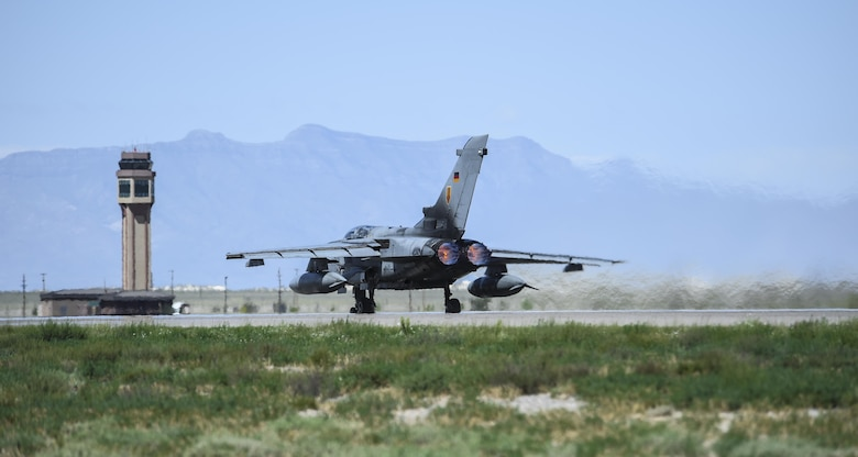 A German air force Tornado aircraft and an F-16 Fighting Falcon perform a final joint flying mission at Holloman Air Force Base, N.M., Aug. 17, 2017. The German air force has entered its final stage of departure, however they are not expected to complete their departure from Holloman AFB until mid 2019. (U.S. Air Force photo by Staff Sgt. Stacy Jonsgaard)
