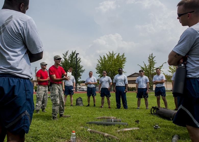 U.S. Air Force Airmen assigned to the 8th Fighter Wing, practice identifying unexploded ordinance during a wing training day at Kunsan Air Base, Republic of Korea, Aug. 18, 2017. The event, hosted by the 8th Civil Engineer Squadron Readiness and Emergency Management Flight, taught Airmen vital skills in the event of an emergency situation. (U.S. Air Force photo by Senior Airman Colville McFee)