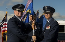 U.S. Air Force Col. Peter P. Feng, incoming 65th Air Base Group commander, receives the group's guidon from U.S. Air Force Brig. Gen. Richard G. Moore, 86th Airlift Wing commander, during a change of command ceremony on Lajes Field, Portugal, Aug. 16, 2017. The 65th ABG is a geographically separated unit that falls under the 86th AW at Ramstein Air Base, Germany. (U.S. Air Force photo by Senior Airman Tryphena Mayhugh)