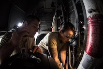 U.S. Air Force Tech. Sgt. Jordan Martinell, 86th Aircraft Maintenance Squadron aerospace electrical and environmental systems craftsman, and Senior Airman Michala Szubinski, 86th AMXS environmental systems journeyman, work on the landing gear of a C-130J Super Hercules in a hangar on Ramstein Air Base, Germany, Aug. 15, 2017. The 86th AMXS is responsible for maintaining all aircraft assigned to the 86th Airlift Wing. (U.S. Air Force photo by Senior Airman Devin Boyer)