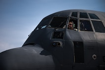 U.S. Air Force Airman 1st Class Robert Allen, 86th Aircraft Maintenance Squadron aerospace propulsion journeyman, sits on the flight deck of a C-130J Super Hercules during an engine start on the flightline on Ramstein Air Base, Germany, Aug. 15, 2017. The maintainers follow a checklist to ensure everything on the aircraft is fully functional. (U.S. Air Force photo by Senior Airman Devin Boyer)