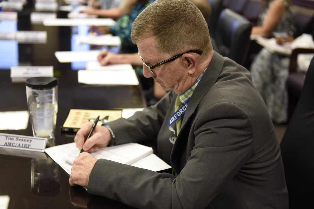 Tim Seaney, Air Mobility Command's Management Level Support division chief, takes notes during the Emotional Intelligence course August 15, 2017