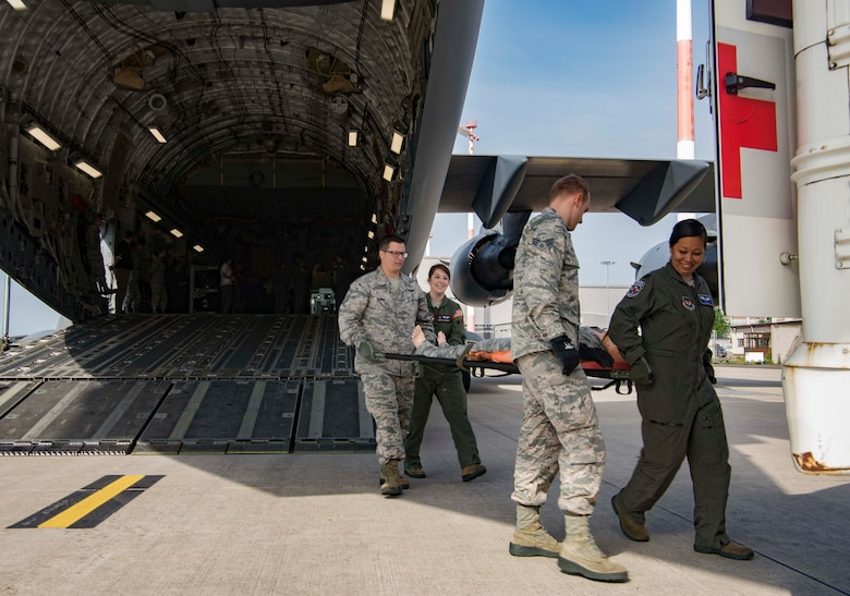 Members of the 86th Medical Group simulate patient transfer from aircraft to medical facility on Ramstein Air Base, Germany, Aug. 15, 2017.