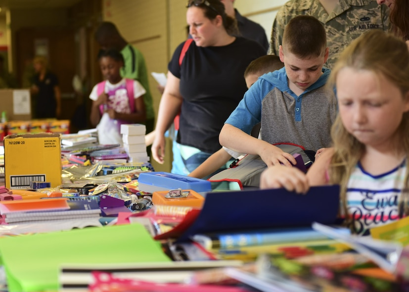 Parents help their children select school supplies during the Back-to-School Brigade event at Whiteman Air Force Base, Mo., Aug. 8, 2017. The event was hosted at the Whiteman Elementary School and was open to all active duty, Air National Guardsmen and reservist with children in grades kindergarten through 12th. (U.S. Air Force photo by Staff Sgt. Danielle Quilla)