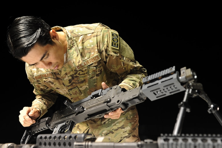 U.S. Air Force Tech. Sgt. Charles Shewmaker, 633rd Civil Engineer Squadron Explosives Ordinance Disposal team lead prepares an M240B machine gun for a weapons familiarization training during Operation Llama Fury 3.0 at Joint Base Langley-Eustis, Va., Aug. 10, 2017. During the final day of OLF 3.0., the EOD teams participated in a variety of skill and knowledge stations, where they competed for the OLF 3.0 trophy. (U.S. Air Force photo/Staff Sgt. Brittany E. N. Murphy)