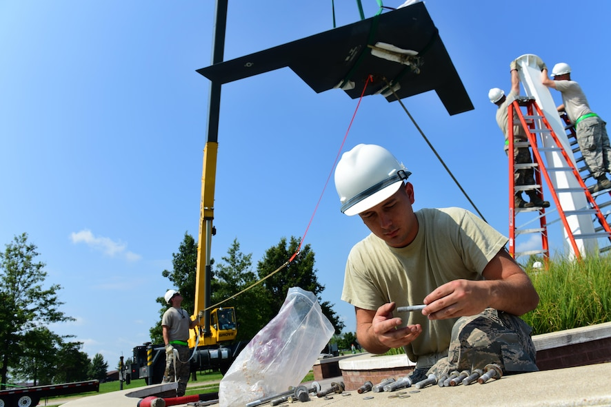 U.S. Air Force Staff Sgt. Jared Parker, a 131st Maintenance Group maintenance flight phase inspection technician, sorts bolts by size at Whiteman Air Force Base, Mo., Aug. 10, 2017. The 600-pound B-2 Spirit replica on display near the Spirit Gate, is secured by eight 5-inch bolts.