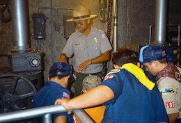 Calvin Foster takes Boy Scouts and Cub Scouts on a tour of the internal workings of the tower portion of Success Dam in 1995, when Foster was a park ranger.