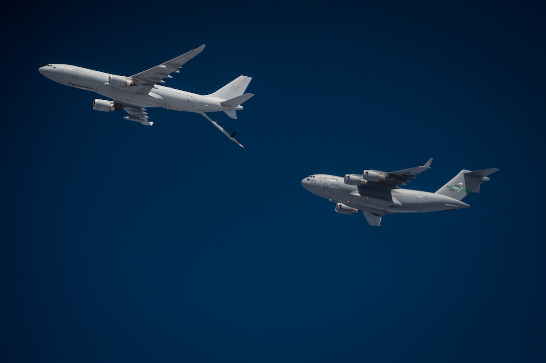 A U.S. Air Force C-17 Globemaster III, approaches a Royal Australian Air Force KC-30A Voyager for refuel during Exercise Mobility Guardian, near Joint Base Lewis-McChord, Wash. Aug. 10, 2017. More than 3,000 Airmen, Soldiers, Sailors, Marines and international partners converged on the state of Washington in support of Exercise Mobility Guardian. The exercise is intended to test the abilities of the Mobility Air Forces to execute rapid global mobility missions in dynamic, contested environments. (U.S. Air Force photo/Tech. Sgt. Larry E. Reid Jr.)