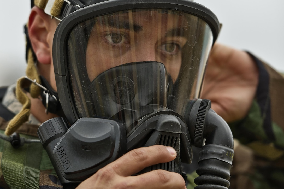 An Airman secures his protective mask as he prepares for a firefighting exercise during exercise Patriot Warrior, Aug. 11, 2017, at Young Air Assault Strip, Fort McCoy, Wis. Patriot Warrior is an Air Force Reserve training exercise designed to enhance wartime skills in a deployment-style environment and evaluate the ability of units to deploy mobility airlift and agile combat support capabilities in support of joint theater operations. (U.S. Air Force photo/Tech. Sgt. Efren Lopez)