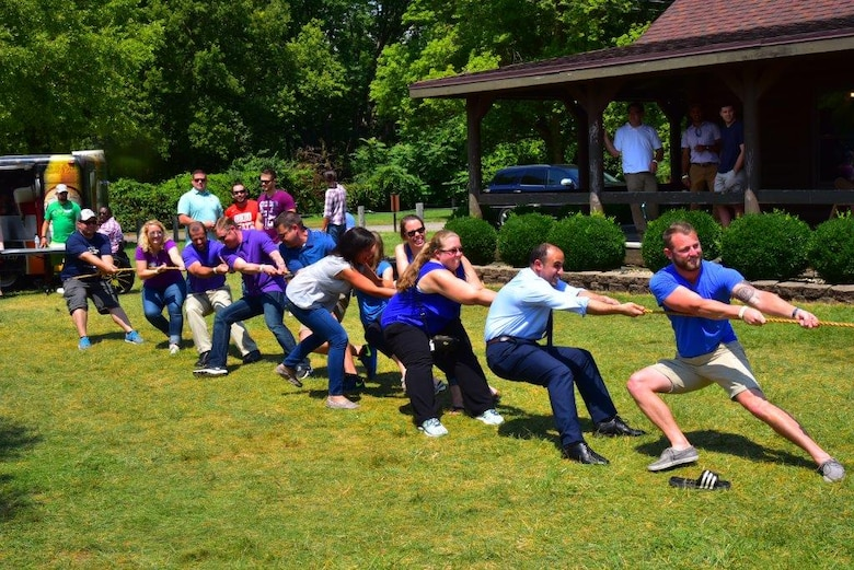 Financial management and contracting interns battle it out with program management interns in a friendly challenge of tug of war at the inaugural Wright-Patterson Air Force Base picnic held at Bass Lake Aug. 10.The PM interns were victorious. (U.S. Air Force photo/Alex Feuling)