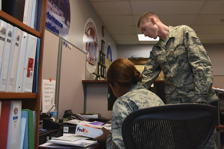 U.S. Air Force Tech. Sgt. Matthew Watts, 17th Medical Support Squadron medical material technician, takes an opportunity to help train Airman Khrystian Anderson, 17th MDSS medical material apprentice, in the Ross Clinic at Goodfellow Air Force Base, Texas, Aug. 16, 2017. The member spotlight went to Watts for his outstanding work ethic and willingness to step up and take on more responsibilities due to a shrinking office.