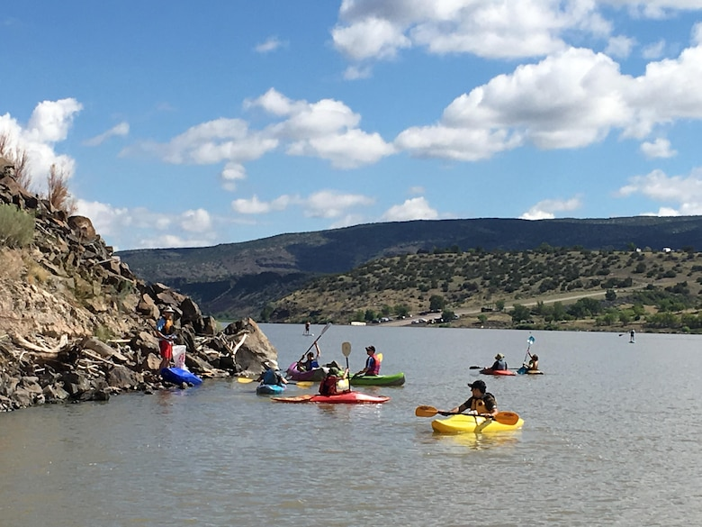 "COCHITI LAKE, N.M. – Volunteers in personal watercraft travel the lake to pick up debris during the ""Cochiti Sweep"" event, Aug. 12, 2017."