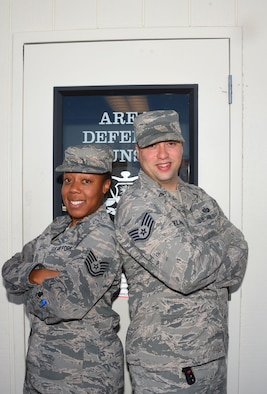 Tech. Sgt. Breyon Davis, 582nd Operations Support Squadron NCO in charge of current operations, and Staff Sgt. Joshua Belanger, Air Force defense paralegal, stand together in front of the Area Defense Counsel building at F. E. Warren Air Force Base, Wyo., Aug. 18, 2017.