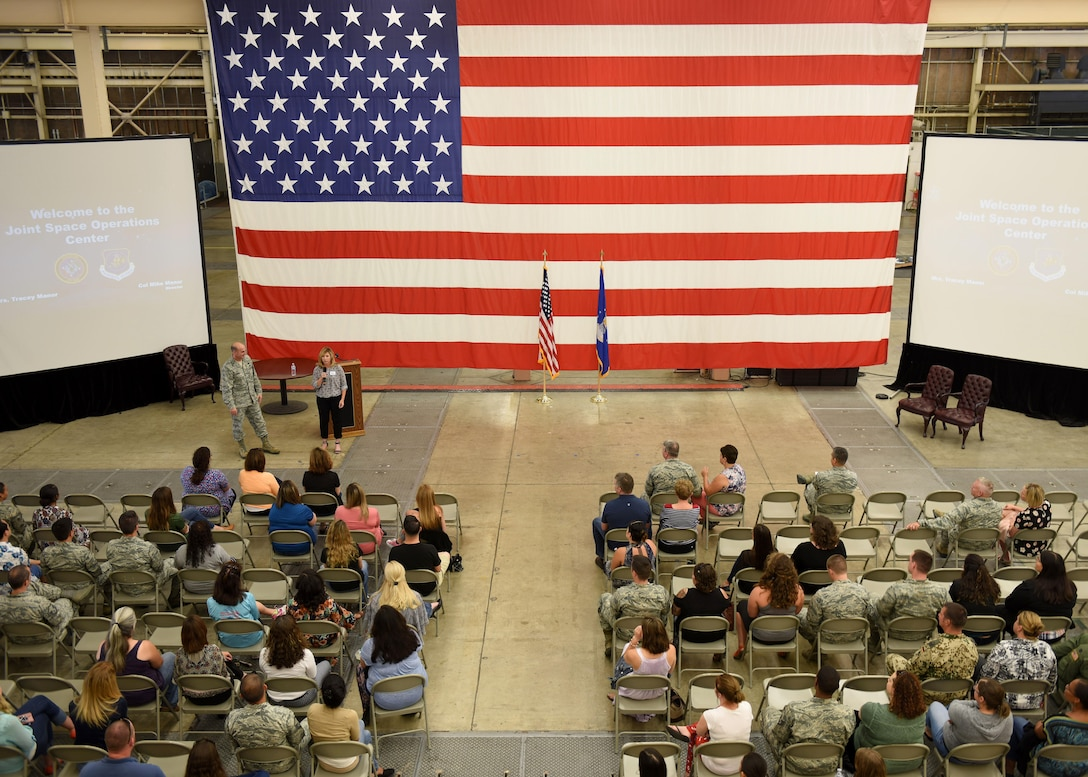 Col. Michael Manor, 614th Air Operations Center commander, and his wife, Tracey Manor, speak to spouses during the Joint Space Operations Command Annual Spouses' Open House, Aug. 17, 2017, Vandenberg Air Force Base, Calif. The open house consisted of a mission brief from Col. Michael Manor, 614th Air Operations Center commander, a welcome brief from Tracey Manor, a tour on the JSpOC operations floor, multiple leadership briefings and a social period in the heritage room. (U.S. Air Force photo by Senior Airman Kyla Gifford/Released)