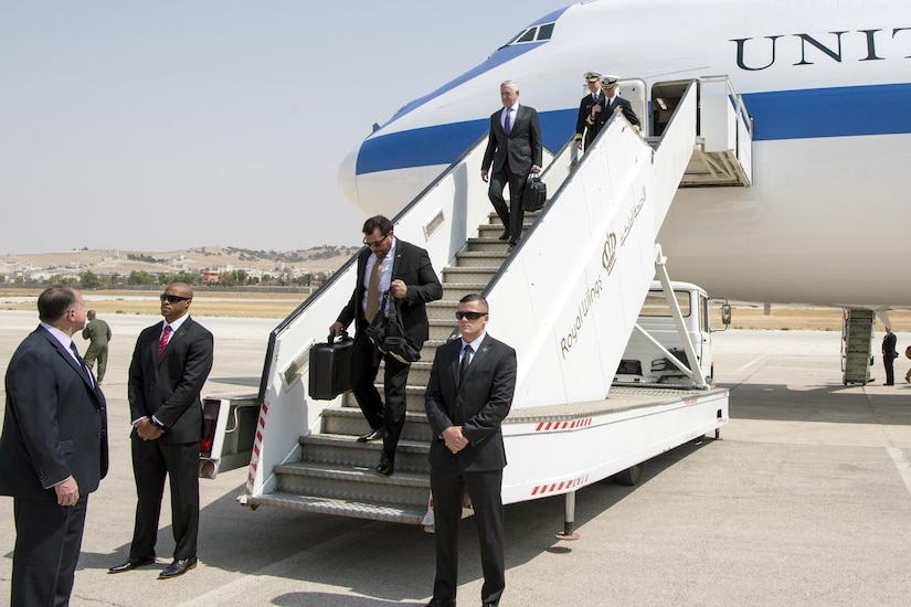 Defense Secretary gets off a plane in Jordan.