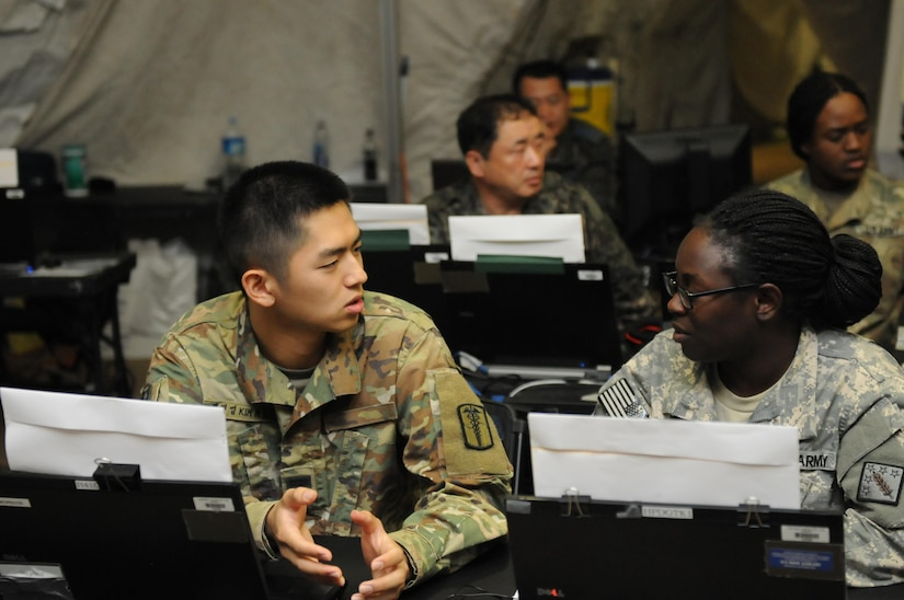 South Korean and U.S. soldiers at computer station.