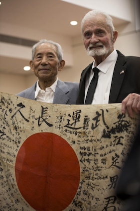 Marine returnes Japanese WWII flag to original family