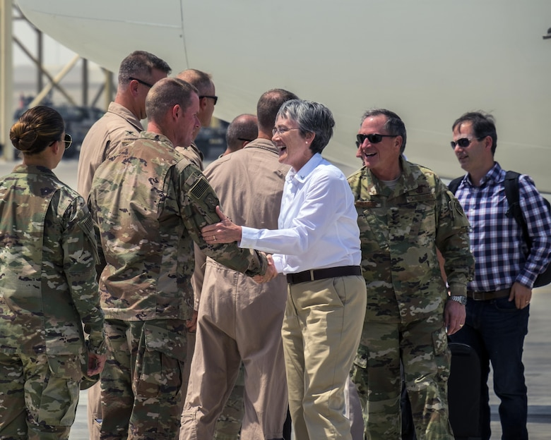 Secretary of the Air Force Heather Wilson, center, and Air Force Chief of Staff Gen. David L. Goldfein are greeted by 380th Air Expeditionary Wing leadership Aug. 18, 2017, Al Dhafra Air Base, United Arab Emirates.