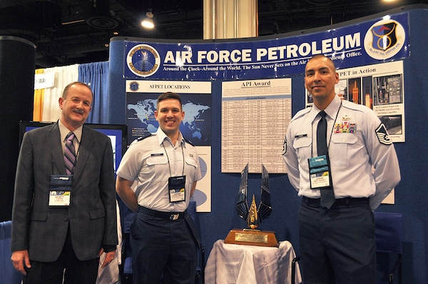 Air Force Petroleum Office representatives stand by booth