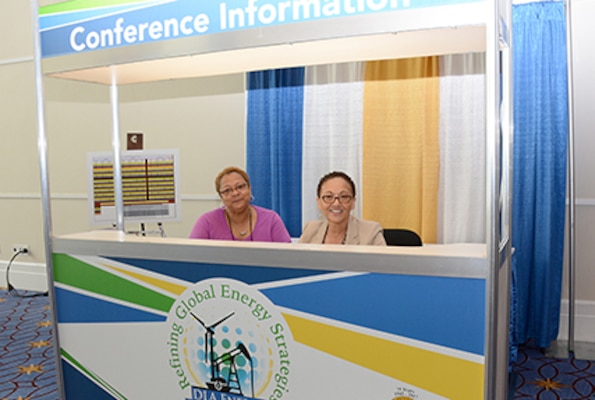 DLA Energy employees work conference information booth