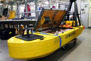 A yellow unmanned vehicle sits on display.
