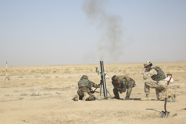 Afghan National Army soldiers with the Helmand Regional Military Training Center fire an 82mm mortar during a training range at Camp Shorabak, Afghanistan, Aug. 17, 2017. More than 60 instructors at the RMTC are undergoing a four-week train-the-trainer course in preparation for an upcoming operational readiness cycle. U.S. Marine advisors with Task Force Southwest are enhancing the infantry knowledge and skills of the instructors to more effectively teach and train soldiers throughout the eight-week ORC. (U.S. Marine Corps photo by Sgt. Lucas Hopkins)