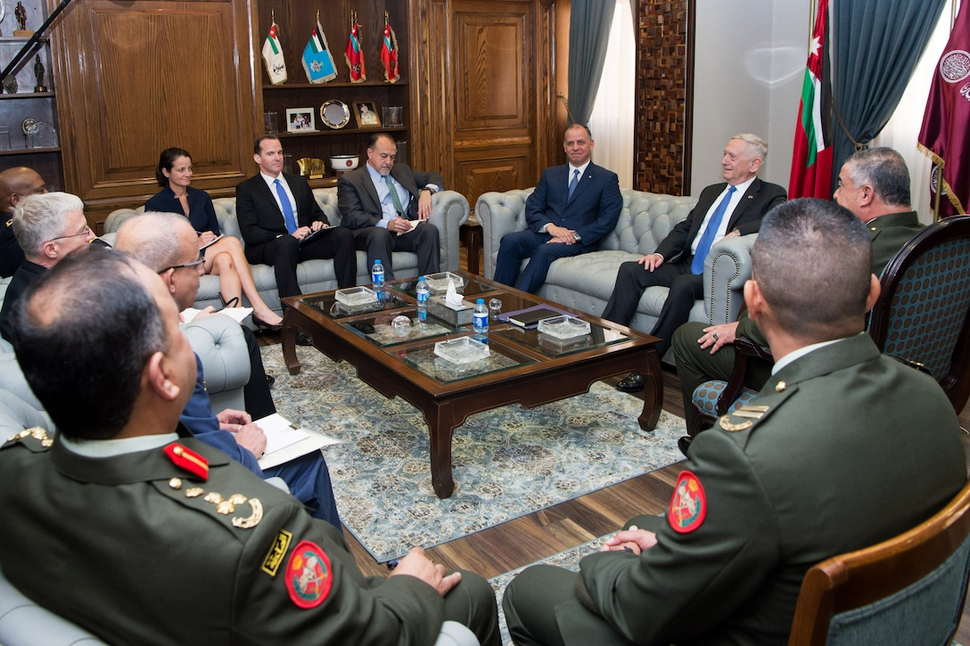Defense Secretary Jim Mattis speaks to a prince of Jordan with a group of people present.
