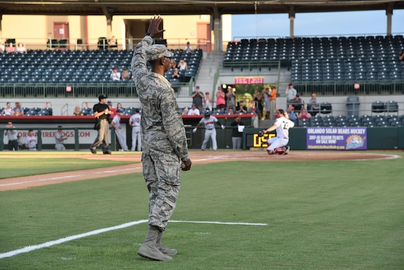 During a Florida Fire Frogs minor league baseball game August 18, 2017, the team not only honored all military and 1st responders, but they took time out to pay special tribute to Senior Airman Kevin Greene, the 920th Rescue Wing's first single amputee to return to military service after a tragic accident resulted in the amputation of part of his left leg. He attended the game with his little girl and girlfriend. (U.S. Air Force photo/Maj. Cathleen Snow)
