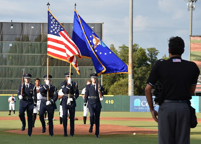 During a Florida Fire Frogs minor league baseball game August 18, 2017, the Patrick Air Force Base Honor Guard presented the colors to honor all military and 1st responders, and to pay special tribute to Senior Airman Kevin Greene, the 920th Rescue Wing's first single amputee to return to military service after a tragic accident resulted in the amputation of part of his left leg. He attended the game with his little girl and girlfriend. (U.S. Air Force photo/Maj. Cathleen Snow)
