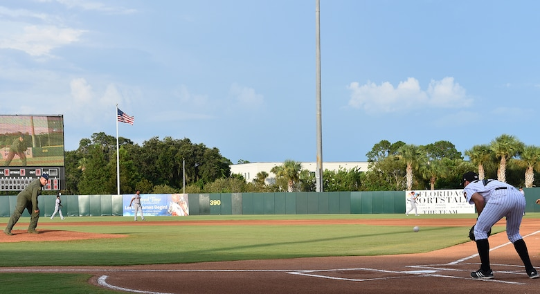 During a Florida Fire Frogs minor league baseball game, Col. Mike 'Yeti' LoForti, 920th Operations Group Commander, threw out the first pitch then the Patrick Air Force Base Honor Guard presented the colors while Master Sgt. Heidi White and her daughter sang the national anthem. The team will not only honored all military and 1st responders, but they took time out to pay special tribute to Senior Airman Kevin Greene, the 920th Rescue Wing's first single amputee to return to military service after a tragic accident resulted in the amputation of part of his left leg. (U.S. Air Force photo/Maj. Cathleen Snow)