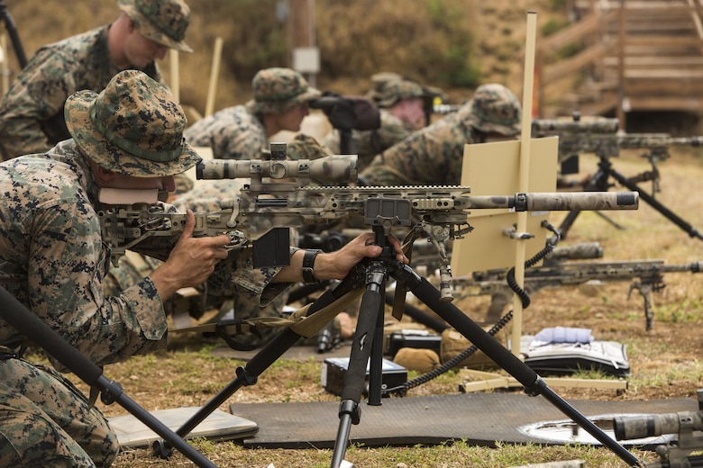 """Scout sniper candidates with Weapons Company, 2nd Battalion, 3rd Marine Regiment, aim down range during a pre-scout sniper course at Pu'uloa Range Training Facility aboard Marine Corps Base Hawaii, August 14, 2017. The known distance qualification course involves firing at moving targets from the 300, 500, and 600 yard lines; engaging """"stop and go"""" and """"bobber"""" targets at the 700 and 800; shooting from the maximum range of 1,000 yards, and is designed to enhance the Marines' capabilities to engage targets at known distances and alternate positions. (U.S. Marine Corps photo by Lance Cpl. Isabelo Tabanguil)"""