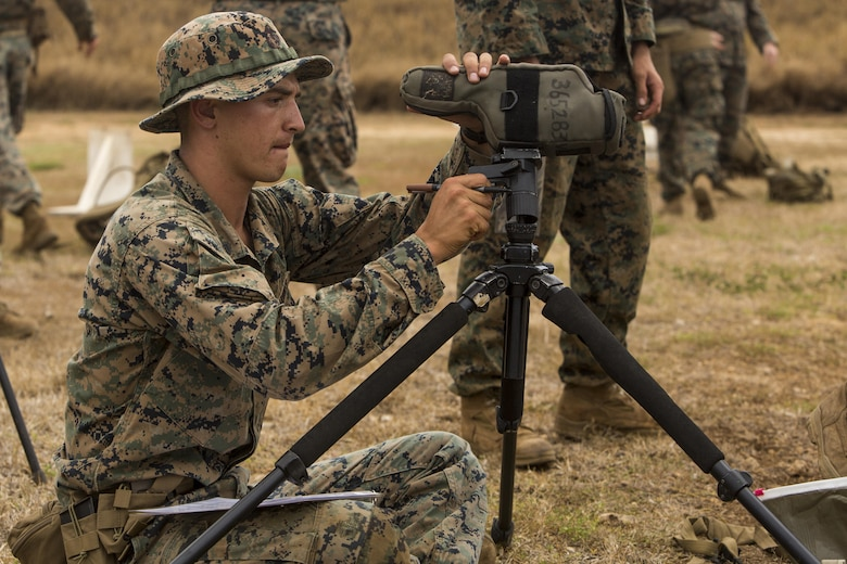Cpl. Austin Cappelletti, a scout sniper candidate with Weapons Company, 2nd Battalion, 3rd Marine Regiment, prepares a spotting scope during a pre-scout sniper course at Pu'uloa Range Training Facility aboard Marine Corps Base Hawaii, August 14, 2017. Spotters help the sniper account for wind, elevation, atmospherics and observe the placement of the last shot the shooter fired. The known distance qualification course is designed to enhance the Marines' capabilities to engage targets at known distances and alternate positions. (U.S. Marine Corps photo by Lance Cpl. Isabelo Tabanguil)