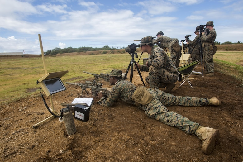 """Scout sniper candidates with Weapons Company, 2nd Battalion, 3rd Marine Regiment, conduct a pre-scout sniper course at Pu'uloa Range Training Facility aboard Marine Corps Base Hawaii, August 14, 2017. The known distance qualification course involves firing at moving targets from the 300, 500, and 600 yard lines; engaging """"stop and go"""" and """"bobber"""" targets at the 700 and 800; shooting from the maximum range of 1,000 yards, and is designed to enhance the Marines' capabilities to engage targets at known distances and alternate positions. (U.S. Marine Corps photo by Lance Cpl. Isabelo Tabanguil)"""