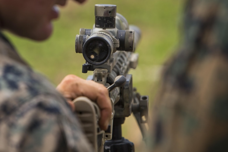 """Scout sniper candidates with Weapons Company, 2nd Battalion, 3rd Marine Regiment, prepare to fire an M40A6 sniper rifle during a pre-scout sniper course at Pu'uloa Range Training Facility aboard Marine Corps Base Hawaii, August 14, 2017. The known distance qualification course involves firing at moving targets from the 300, 500, and 600 yard lines; engaging """"stop and go"""" and """"bobber"""" targets at the 700 and 800; shooting from the maximum range of 1,000 yards, and is designed to enhance the Marines' capabilities to engage targets at known distances and alternate positions. (U.S. Marine Corps photo by Lance Cpl. Isabelo Tabanguil)"""