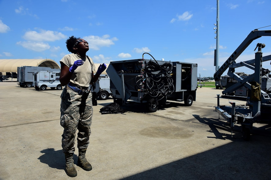 Airman 1st Class Janay Mack, 4th Equipment Maintenance Squadron aerospace ground equipment mechanic, looks at a solar eclipse, Aug. 21, 2017, at Seymour Johnson Air Force Base, North Carolina. Over the course of 100 minutes, 14 states across the United States experienced more than two minutes of darkness throughout the day. (U.S. Air Force photo by Airman 1st Class Kenneth Boyton)