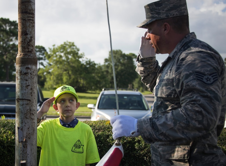 Honor Guard teaches Eglin Elementary School safety patrol flag detail.