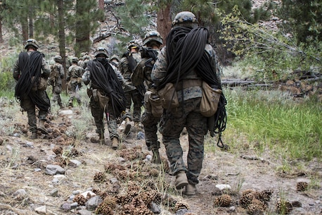 Marines from 2nd Battalion, 8th Marine Regiment, hike to a potential climbing route for their night climb during Mountain Training Exercise 4-17 aboard Marine Corps Mountain Warfare Training Center, Bridgeport, Calif., August 1, 2017. Marines with 2/8, based out of Marine Corps Base Camp Lejeune, N.C., conducted the training in preparation for an upcoming deployment. (U.S. Marine Corps photo by Pfc. Margaret Gale)
