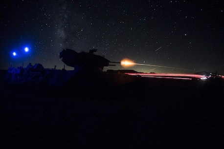 Marines fire an M2 .50 caliber machine gun, mounted to an amphibious assault vehicle, at simulated enemy targets during Large scale Exercise-17 at Twentynine Palms, Calif., Aug. 15-18, 2017. LSE-17 is a multinational exercise, led by 2nd Marine Division, with elements from the United Kingdom, France, Canada and II Marine Expeditionary Force, focused on integrating all capabilities of the Marine Air-Ground Task Force and coalition forces.