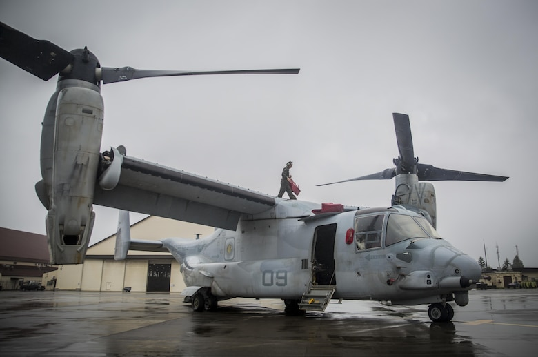 A U.S. Marine maintains a MV-22 Osprey at Misawa Air Base, Japan, August 9, 2017, signifying the start of exercise Northern Viper 2017.